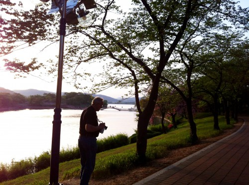 Dad checks his camera by the river in Gyeongju